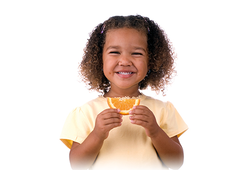 Girl eating an orange